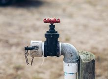 A washdown tap in a vineyard.
